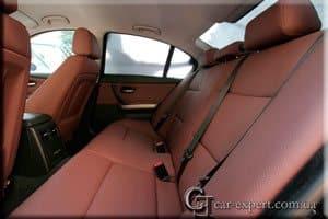 Перетяжка салона кожей BMW E90